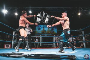 "Former EPW Champion ""The Don"" Michael Morleone and Zenith attack one another with Steel chairs"